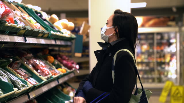 woman with face mask buying vegetables and fruits in supermarket - elegance stock videos & royalty-free footage