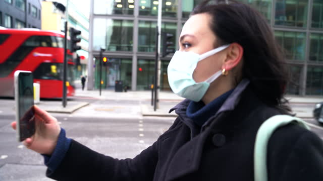 woman with face mask making video call - walkable city stock videos & royalty-free footage