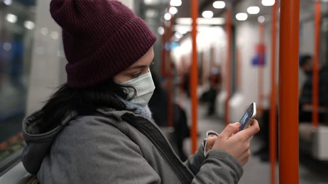 woman with face mask using smart phone inside thetrain - cinematography stock videos & royalty-free footage