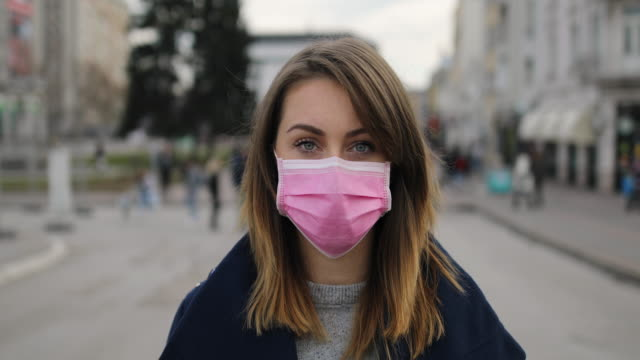 woman with face protective mask - serbia stock videos & royalty-free footage