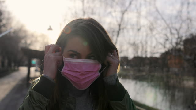 woman with face protective mask - protective face mask stock videos & royalty-free footage
