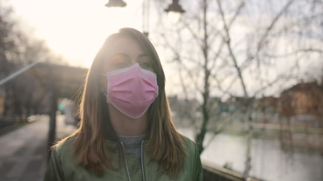 woman with face protective mask - pollution mask stock videos & royalty-free footage