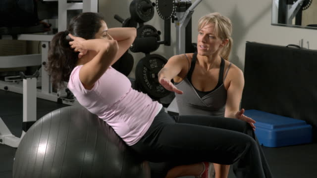 ms, td, tu, woman with female trainer exercising in gym, garwood, new jersey, usa - tre quarti video stock e b–roll