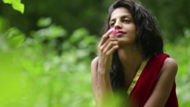 woman with flower in a forest, malshej ghat, maharashtra, india - frische stock-videos und b-roll-filmmaterial