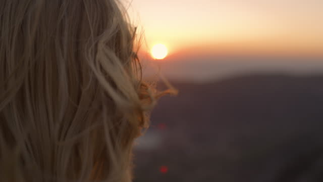 slo mo woman with flying hair enjoying the sunset over the sea - long hair stock videos & royalty-free footage