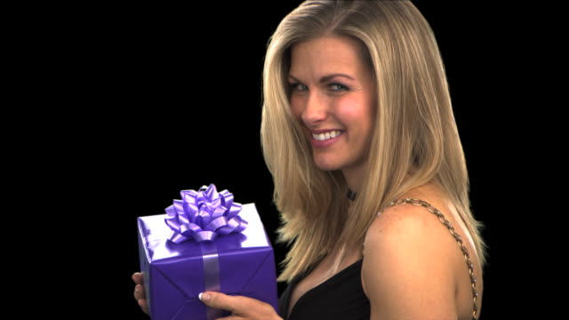 woman with gift close-up - this clip has an embedded alpha-channel - pre matted stock videos & royalty-free footage