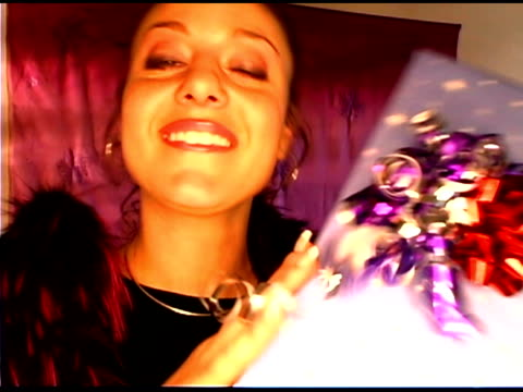 woman with gift - see other clips from this shoot 1407 stock videos and b-roll footage