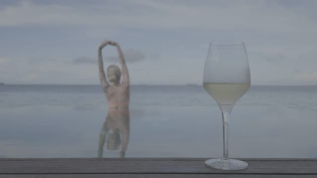 Woman with Glass of Wine by the Pool - Cinemagraph in Flat Colors