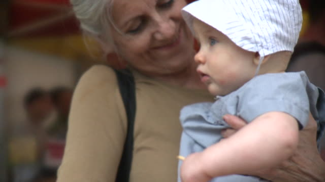 cu td selective focus woman with granddaughter (6-11 months) holding parsnip, new york city, new york, usa - 6 11 months stock videos & royalty-free footage