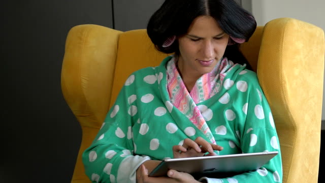 woman with hair curlers working - bathrobe stock videos & royalty-free footage