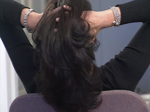 woman with hands in hair - hand in hair stock videos & royalty-free footage