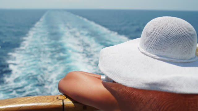 woman with hat enjoying a view on the cruise ship - cruise stock videos & royalty-free footage