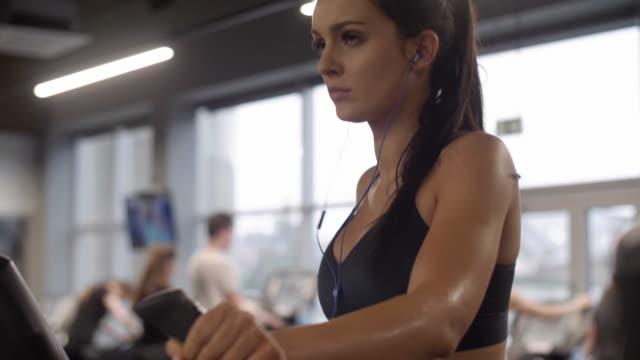 Woman with headphones exercising/ Mielec/ Poland