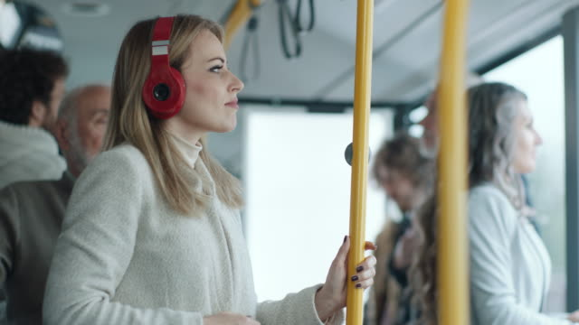woman with headphones on the bus - bosnia and hercegovina stock videos & royalty-free footage