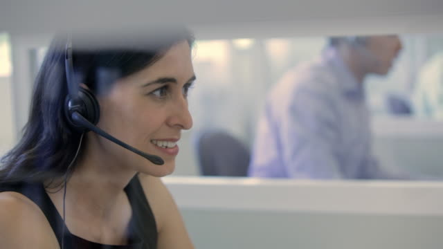 cu woman with headset in call centre / vancouver, british columbia, canada - headset stock videos & royalty-free footage