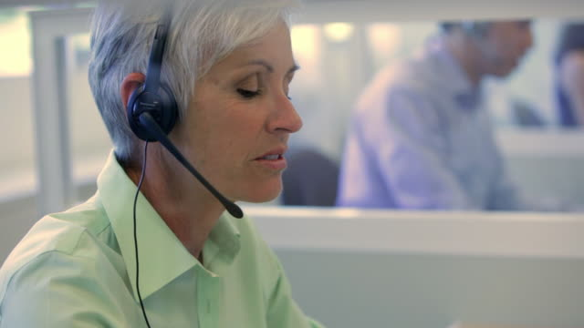 cu woman with headset in call centre / vancouver, british columbia, canada - short hair stock videos & royalty-free footage