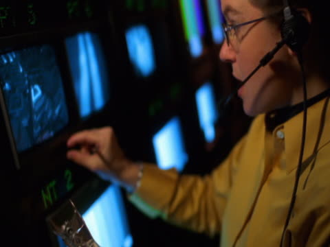 Woman with headset in TV control room
