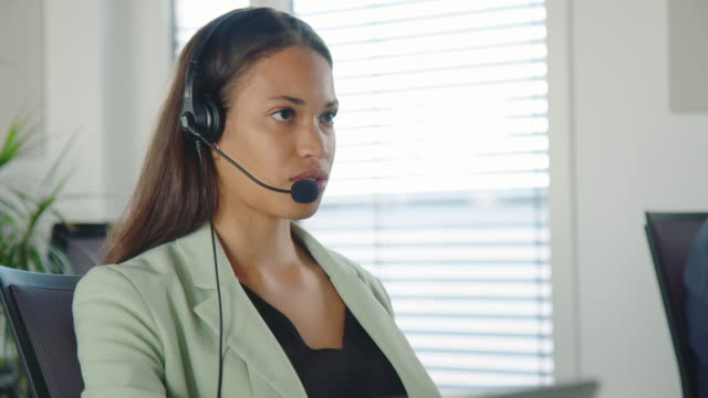 woman with headset on call with a customer - customer focused stock videos & royalty-free footage