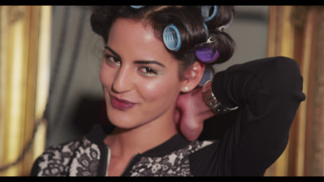 A woman with her hair in rollers