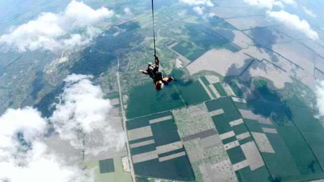 woman with instructor in free fall. - skydiving stock videos & royalty-free footage