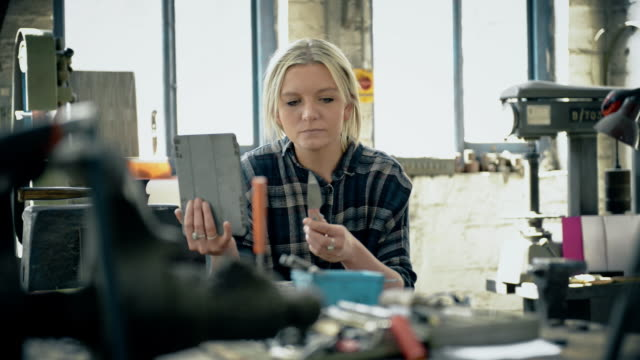 woman with knives and digital tablet - genderblend stock videos & royalty-free footage