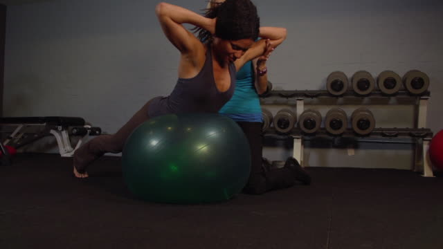 """""""MS TS Woman with lady trainer doing workout on yoga ball / Beverly Hills, California, United States """""""