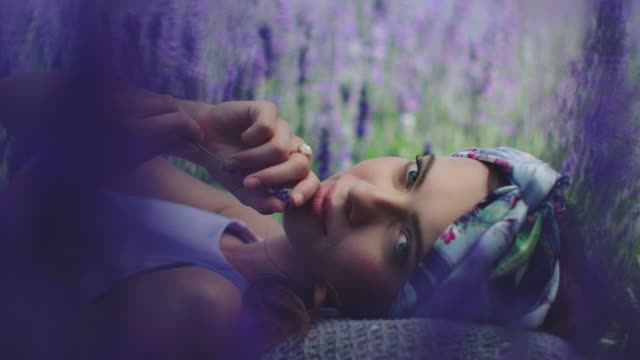 woman with lavender flowers resting on field - lying down stock videos & royalty-free footage