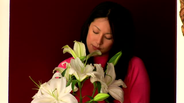 woman with lilies - stargazer lily stock videos & royalty-free footage