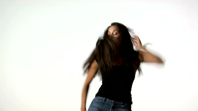 woman with long hair dancing and smiling - tre quarti video stock e b–roll