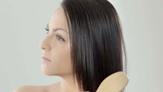 woman with long healthy looking hair - long hair stock videos and b-roll footage