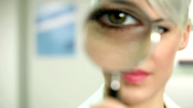 woman with magnifying glass - magnifying glass stock videos & royalty-free footage