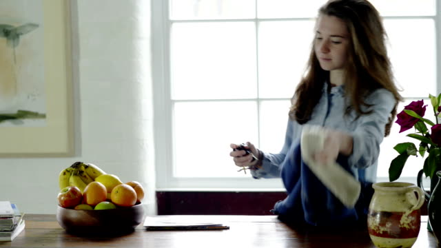 woman with mail and apple - postcard stock videos & royalty-free footage