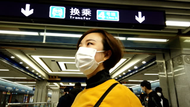 woman with mask in subway station - underground train stock videos & royalty-free footage