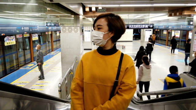 woman with mask in subway station - protective face mask stock videos & royalty-free footage