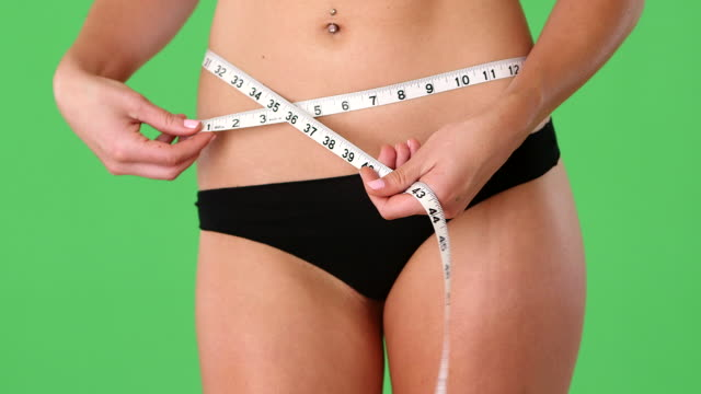 woman with measuring tape at waist - navel stock videos & royalty-free footage