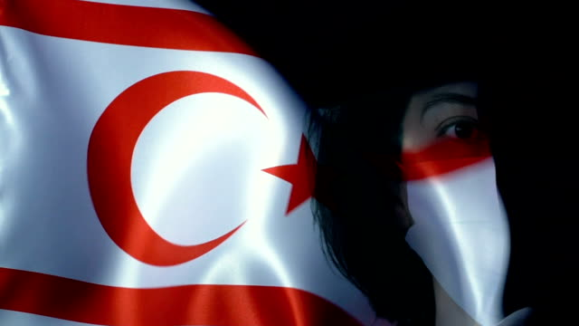 woman with protective face mask on cyprus turkish republic flag. protection for viruses and infections. - black hair stock videos & royalty-free footage