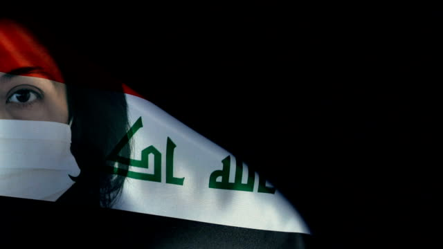 woman with protective face mask on iraqi flag. protection for viruses and infections. - baghdad stock videos & royalty-free footage