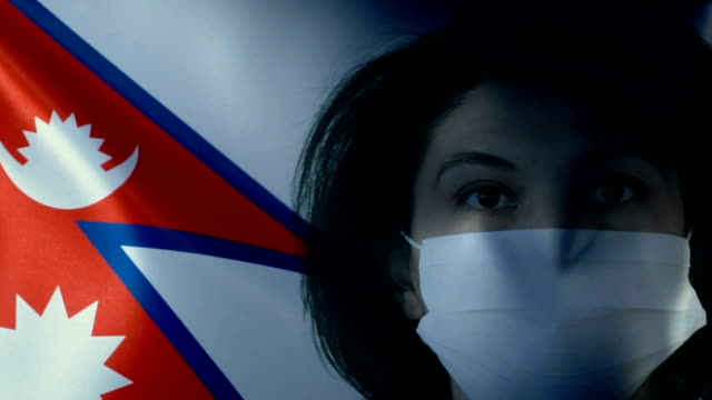 woman with protective face mask on nepali flag. protection for viruses and infections. - nepali flag stock videos & royalty-free footage