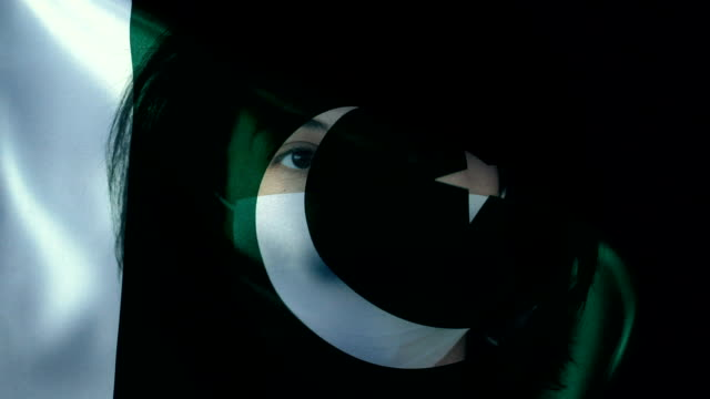 woman with protective face mask on pakistani flag. protection for viruses and infections. - pakistani flag stock videos & royalty-free footage