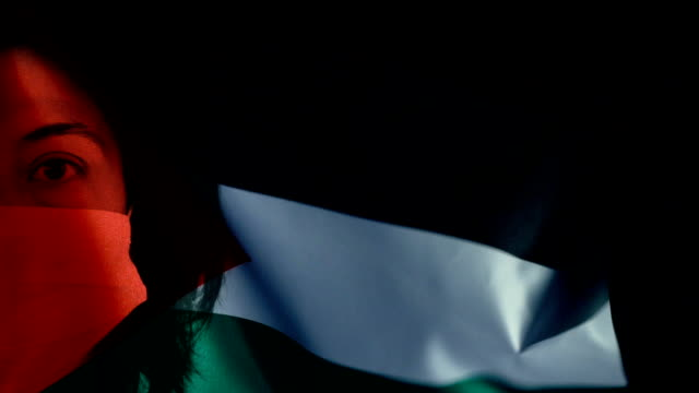 woman with protective face mask on palestine flag. protection for viruses and infections. - palestinian stock videos & royalty-free footage