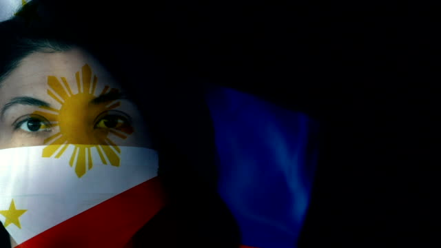 woman with protective face mask on philippines flag. protection for viruses and infections. - philippines flag stock videos & royalty-free footage