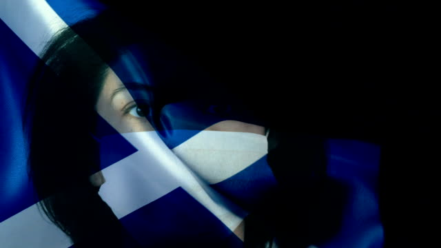 woman with protective face mask on scottish flag. protection for viruses and infections. - scottish flag stock videos & royalty-free footage
