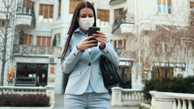 woman with protective mask on city street - covering stock videos & royalty-free footage