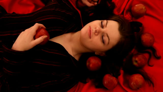 woman with red apples on silk - bedtime stock videos and b-roll footage