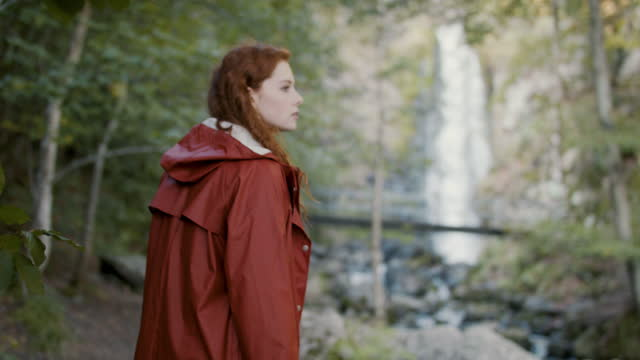 woman with red hair in lush forest with waterfall - fairytale stock videos & royalty-free footage