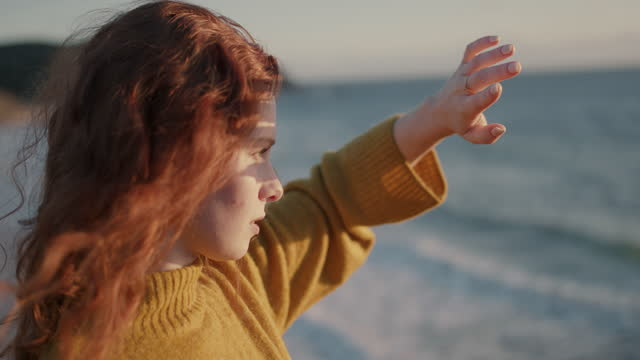 woman with red hair looking into sun - spirituality stock videos & royalty-free footage