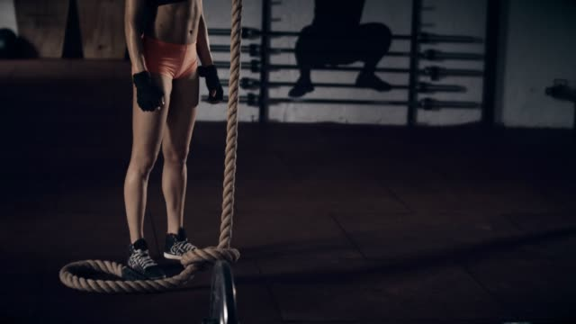Woman with rope in gym