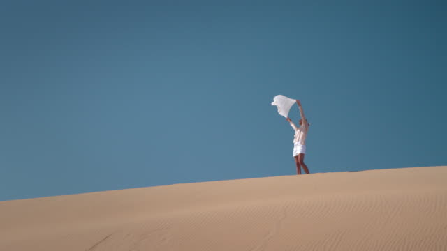 Woman with scarf in desert