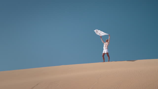 woman with scarf in desert - scarf stock videos & royalty-free footage