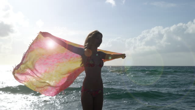 woman with scarf on a beach - sarong stock videos and b-roll footage